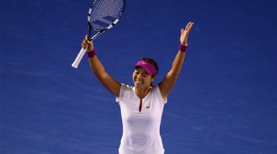 Li Na celebrates winning her women's singles final against Dominika Cibulkova [AFP]