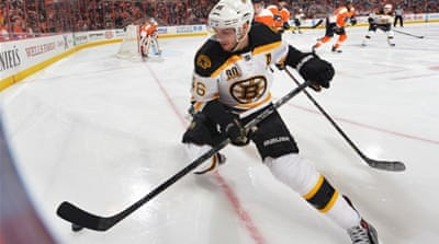 David Krejci of the Boston Bruins controls the puck in the Philadelphia Flyers zone [AFP]