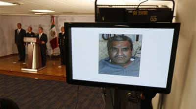 A picture of kingpin Dionisio Loya Plancarte was shown during a news conference at the Interior Ministry [Reuters]