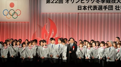 Japanese Prime Minister Shinzo Abe delivers a speech to Jappan's Winter Olympic delegation in Tokyo [AFP]