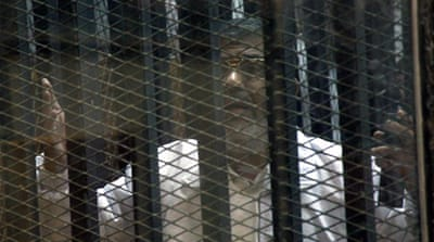 Mohamed Morsi photographed through bars at his appearance last week [AP]