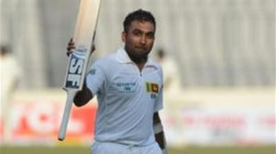 Mahela Jayawardene brought up his 200 with a six before Sri Lanka declared their innings [AFP]