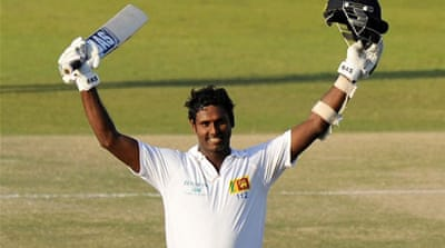 Sri Lankan captain Angelo Mathews celebrates his century during the fourth day of the first Test match [AFP]