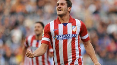 Atletico Madrid's midfielder Koke celebrates after scoring the winning goal against  Malaga [AFP]