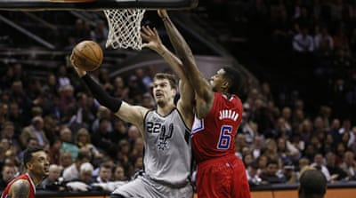 Spurs forward Tiago Splitter (22) had 22 points before he went off with a shoulder injury [Reuters]