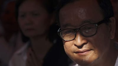 Cambodia opposition leaders summoned to court