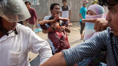 A crackdown on the garment workers' strike killed at least four and injured dozens more [AFP]
