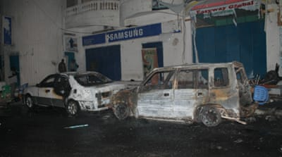 The car exploded in front of the Aroma cafe in Mogadishu [Mustaf Abdi/Al Jazeera]