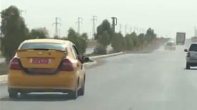 Iraq taxi drivers struggle to bypass conflict