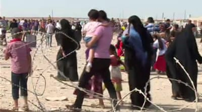 Iraq refugees tell of life under ISIL