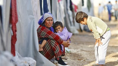 Syria neighbours call for help with refugees