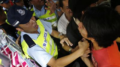 A protester nods off during a recent night demonstration in the Admiralty area [Amy Chew/Al Jazeera]