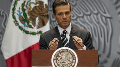 Pena Nieto is facing the deepest crisis of his presidency after the students' abduction in late September [AP]