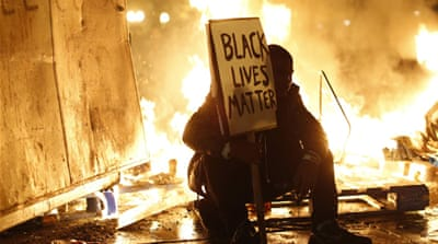 Scores arrested in riots over Ferguson ruling