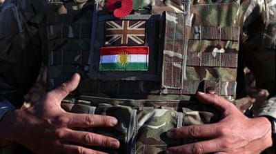 A British military adviser instructs Kurdish Peshmerga fighters during a training session in Arbil [AFP/Getty Images]