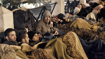 Syrian hunger-strikers demonstrate outside the Greek parliament in Athens on Tuesday [Milos Bicanski/Al Jazeera]