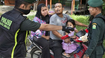 In Pictures: New Islamic law in Indonesia