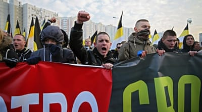 Nationalists hit the streets of Moscow during the annual Russian March on Tuesday [Mansur Mirovalev/Al Jazeera]