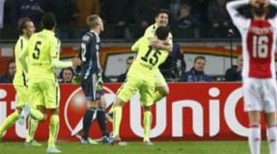 Messi (L) has now scored at 23 stadiums in the Champions League, a new record [Reuters]