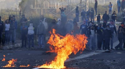 Youths torched tyres and hurled stones, but were pushed back by heavily-armed Israeli police forces [EPA]