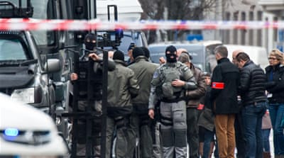 Special forces police in Ghent, western Belgium, arrested several men in an alleged hostage crisis [AP]