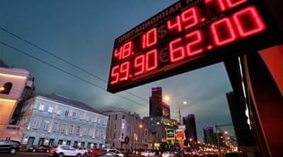 Amid falling oil prices and sanctions, the ruble has lost nearly a quarter of its value so far this year [AFP]