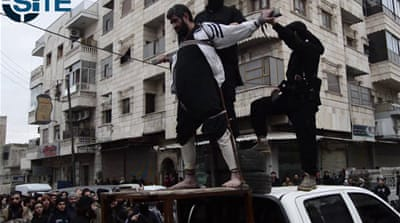 SITE has obtained footage showing the crucifixion of an alleged government spy in Aleppo [Screen shot]