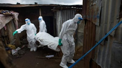 WHO says Ebola cases pass 20,000