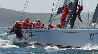 The crew of Wild Oats XI left Sydney Harbour in second place to Comanche at the start of the race [AP]