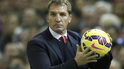 Rodgers slips away from sack race