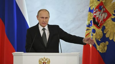 Putin defends foreign policy in state address