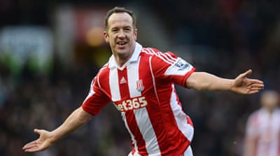 Charlie Adam of Stoke City celebrates scoring one of his double against Manchester United [Getty Images]