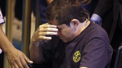 Jose Salvador Alvarenga was overcome with emotion after arriving at San Salvador airport [Reuters]
