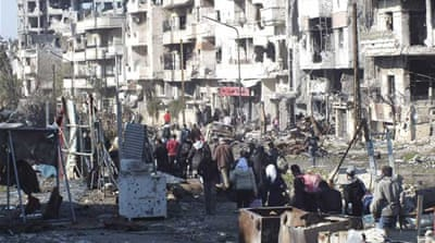 About 3,000 people were trapped in rebel-held areas in Homs for more than 18 months [Reuters]