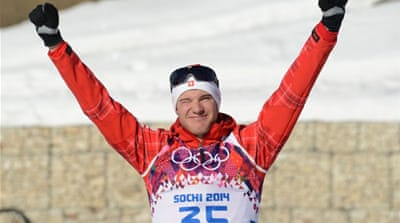 Switzerland's Dario Cologna retains his Vancouver Olympic title in the Sochi men's 15km cross-country [AFP]