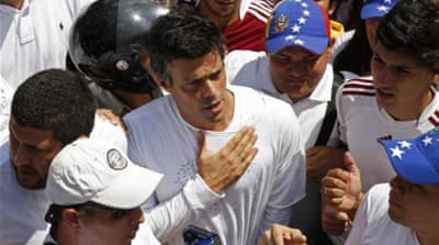 Lopez surrendered himself to police in Caracas on Tuesday in front of thousands of his supporters [AFP]