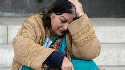 Fatima Khan, mother of a British doctor who died in a Syrian jail, campaigned in Geneva during recent talks [AFP]