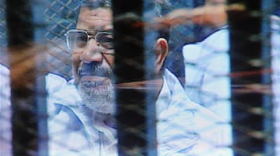 A defiant Morsi has interrupted past court proceedings by saying that he is still Egypt's legitimate leader [AP]