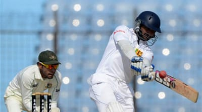 Sri Lanka batsman Kumar Sangakkara plays a shot as Bangladesh captain Mushfiqur Rahim looks on [AFP]