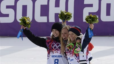 Jamie Anderson celebrates with Finland's Enni Rukajarvi and Great Britain's Jenny Jones [AFP]