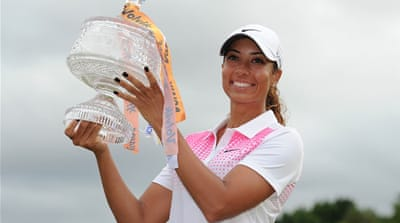 Cheyenne Woods holds the winners trophy after the Ladies Masters at Royal Pines Resort [Getty Images]