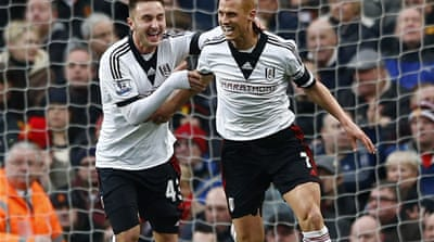 Steve Sidwell celebrates scoring the game's opening goal against Manchester United [Reuters]