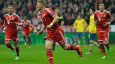 Schweinsteiger (c), who gave Bayern the lead, had missed the first-leg of the last-16 tie [AFP]