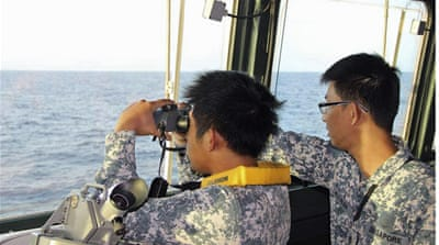 China 'will not give up' on Malaysia MH370