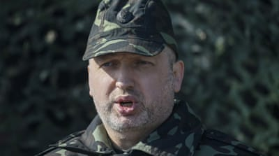 Ukraine president strengthens military