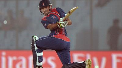 Nepal's rise in cricket makes a stark comparison with the political divisions plaguing the country [AFP]