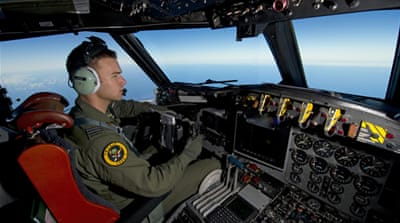 Malaysia plane search paused for night