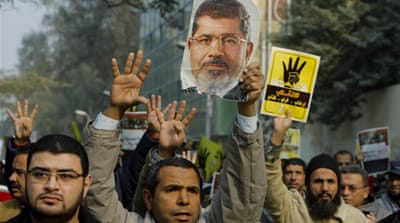 The hearing in the southern province of Minya comes amid a brutal crackdown on Morsi supporters [Reuters]