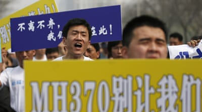 MH370 passengers' relatives protest in China