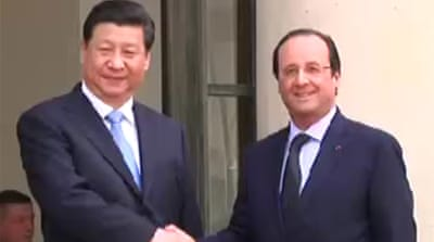China signs major business deals with France